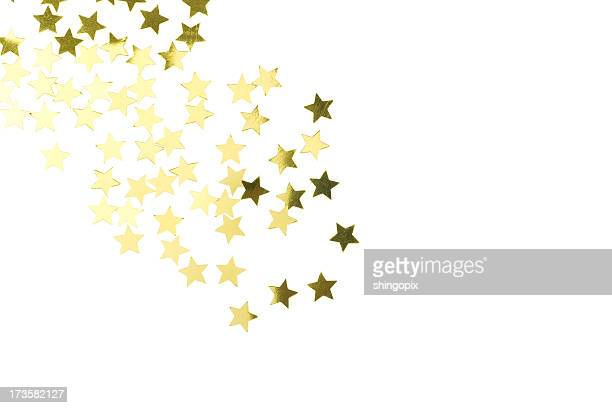 Golden star confetti scattered on white background