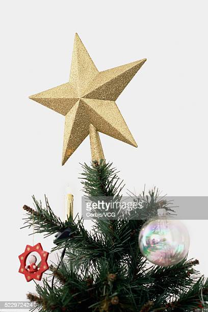Golden Star on the top of Christmas Tree