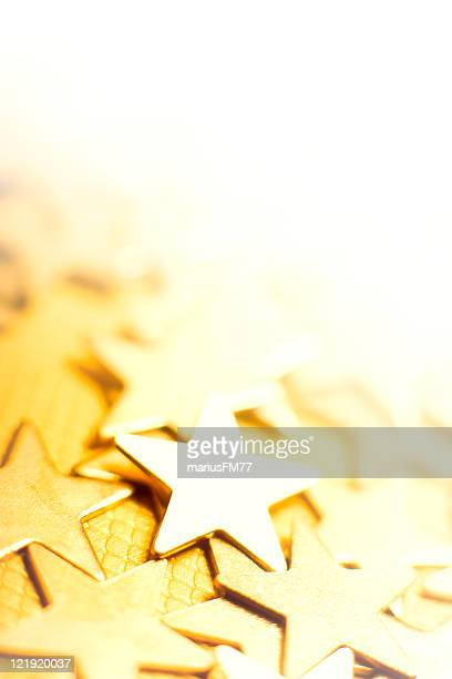 Golden stars in bright background
