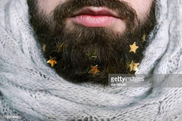 golden stars in man's beard - irony stockfoto's en -beelden