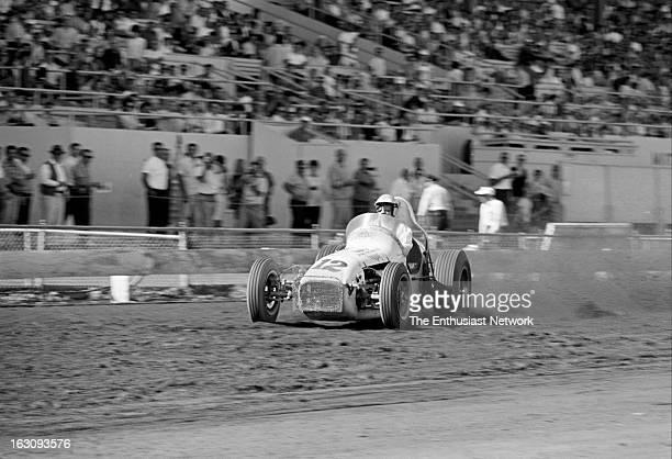 Golden State 100 - Dirt Oval Sprint Car Race - Sacramento. Mario Andretti of the Dean Van Lines team drives an Offenhauser powered Kuzma to a third...
