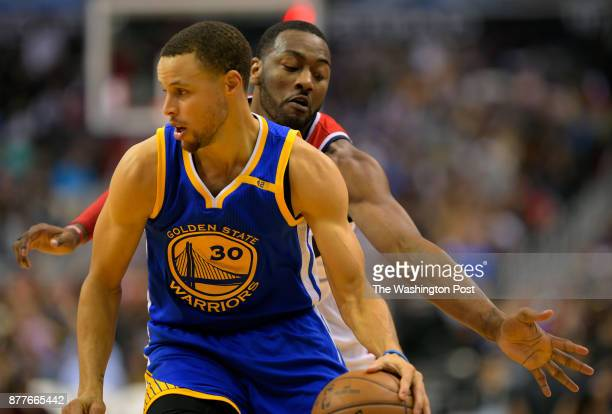 Golden State guard Stephen Curry left is guarded by Washington guard John Wall during the Washington Wizards defeat of the Golden State Warriors...