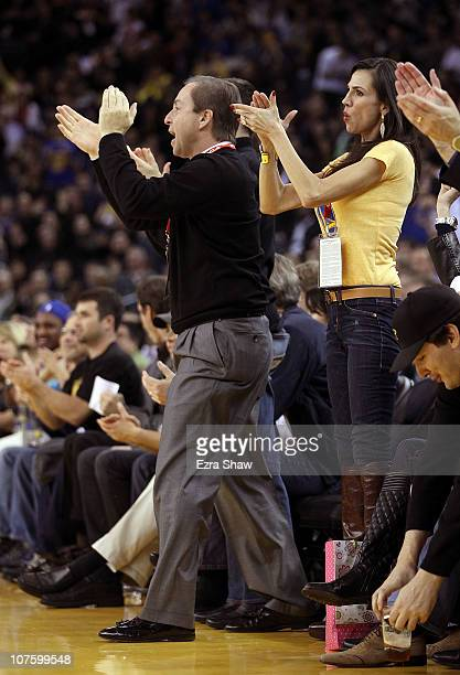 Golden State Warrior co-owner Joe Lacob and Nicole Curran cheer for the Warriors during their game against the Minnesota Timberwolves at Oracle Arena...