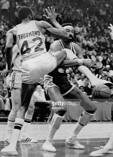 Golden State Warrior Nate Thurmond caught Los Angeles Lakes Wilt Chamberlain with his right leg for a foul early in first period. Chamberlain in self...
