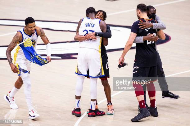 Golden State Warriors and Cleveland Cavaliers players hug after the game at Rocket Mortgage Fieldhouse on April 15, 2021 in Cleveland, Ohio. The...