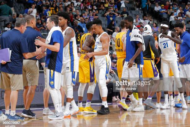 Golden State Warriors and Los Angeles Lakers shake hands during the 2018 Summer League at the Golden 1 Center on July 5 2018 in Sacramento California...