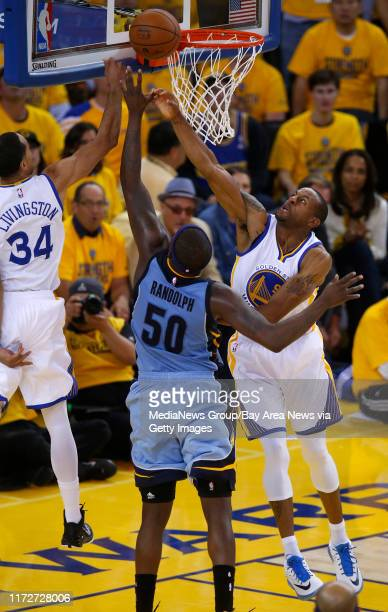 Golden State Warriors' Andre Iguodala and Golden State Warriors' Shaun Livingston guard against Memphis Grizzlies' Zach Randolph in the fourth...