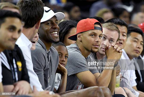 Golden State Warriors Andre Iguodala and Stephen Curry watches play from court side of the China Men's National Team against the United States Men's...