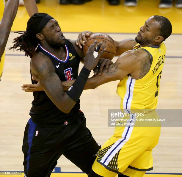 Golden State Warriors' Andre Iguodala battles for the ball with Los Angeles Clippers' Montrezl Harrell during the third quarter of Game 2 of their...