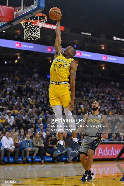 Golden State Warriors' Andre Iguodala goes up for a dunk past Indiana Pacers' Cory Joseph during the first quarter of their NBA game at Oracle Arena...