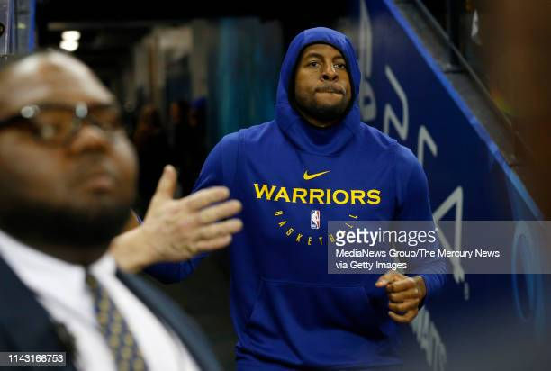 Golden State Warriors' Andre Iguodala heads to the court to warm up before Game 2 of their NBA first round playoff series at Oracle Arena in Oakland...