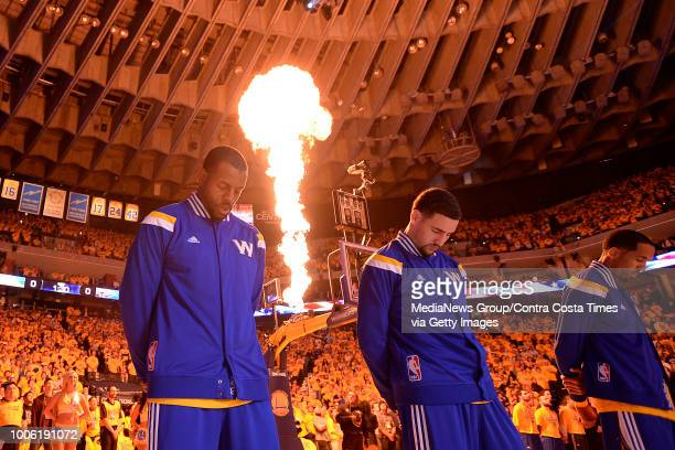 Golden State Warriors' Andre Iguodala Klay Thompson and Shaun Livingston stand during the playing of the national anthem before playing the New...