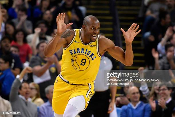 Golden State Warriors' Andre Iguodala reacts after making a dunk against the Indiana Pacers during the third quarter of their NBA game at Oracle...