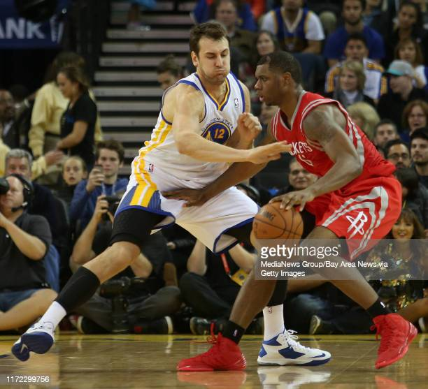 Golden State Warriors' Andrew Bogut guards Houston Rockets' Terrence Jones during the fourth quarter of their game at Oracle Arena in Oakland Calif...