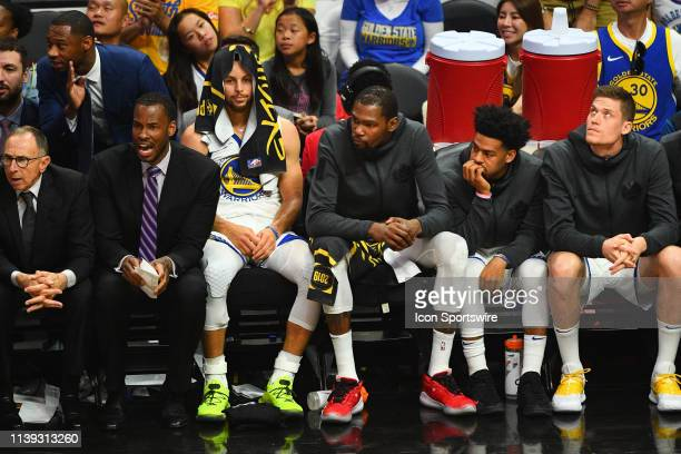 Golden State Warriors assistant coach Ron Adams, Jarron Collins, guard Stephen Curry , forward Kevin Durant , guard Quinn Cook and forward Jonas...