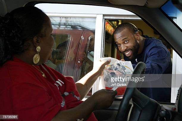 Golden State Warriors' Baron Davis gives away game tickets along with food order to a fan at the drivethru window of McDonald's March 28 2007 in...