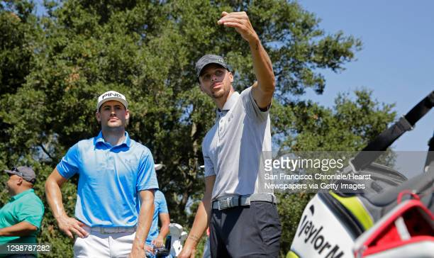 Golden State Warriors basketball star Stephen Curry, on Tues. August 1 with playing partner Taylor Moore on the 17th tee during a practice round for...