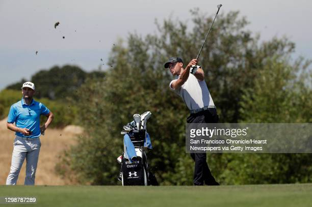 Golden State Warriors basketball star Stephen Curry, on Tues. August 1 watches his approach shot on the 15th hole during a practice round for the...