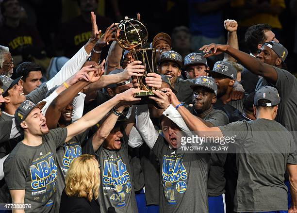 Golden State Warriors celebrate after defeating the Cleveland Cavaliers in Game 6 to win the 2015 NBA Finals June 16 2015 at the at Quicken Loans...