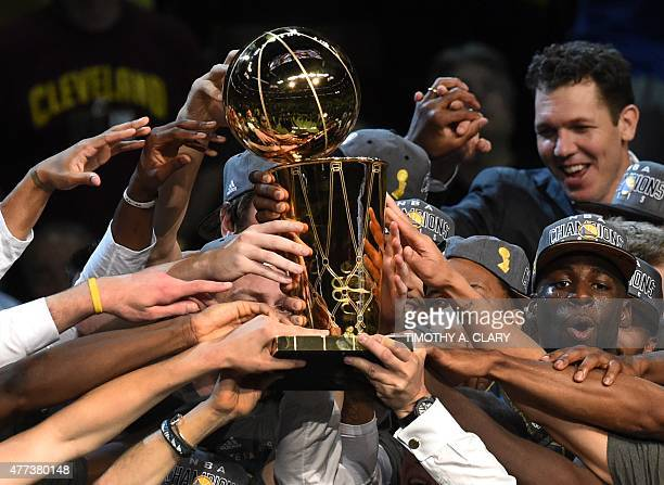 Golden State Warriors celebrate after defeating the Cleveland Cavaliers in Game 6 to win the 2015 NBA Finals on June 16 2015 at the Quicken Loans...