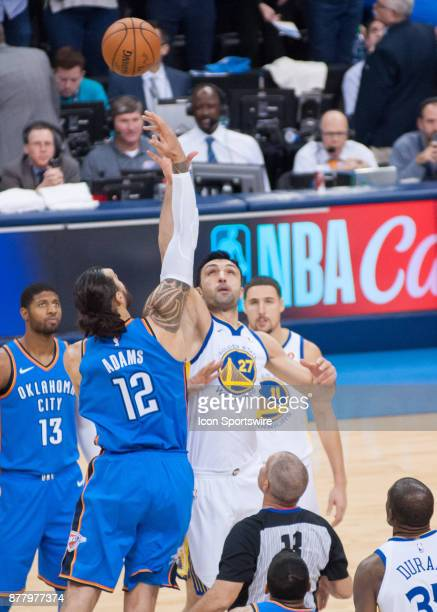 Golden State Warriors Center Zaza Pachulia and Oklahoma City Thunder Center Steven Adams tip off at the Chesapeake Energy Arena Oklahoma City OK