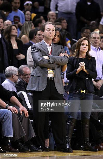 Golden State Warriors co-owner Joe Lacob and Nicole Curran watch the Warriors play the Indiana Pacers at Oracle Arena on January 19, 2011 in Oakland,...