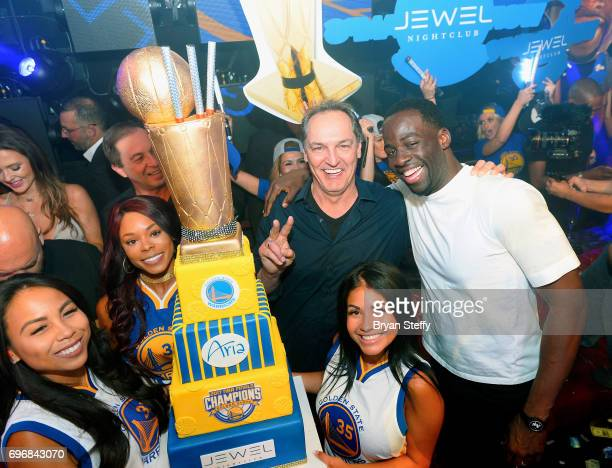 Golden State Warriors coowner Joe Lacob and professional basketball player Draymond Green of the Golden State Warriors celebrate winning the NBA...