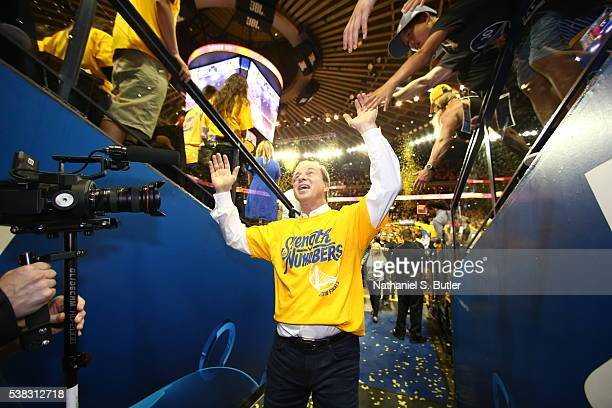 Golden State Warriors coowner Joe Lacob high fives fans after Game Two of the 2016 NBA Finals against the Cleveland Cavaliers on June 5 2016 at...