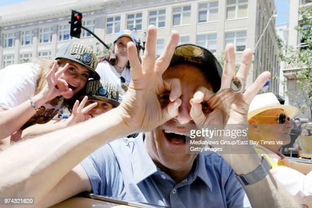 Golden State Warriors coowner Peter Guber makes the signal of three championships during the Warriors championship parade in downtown Oakland Calif...