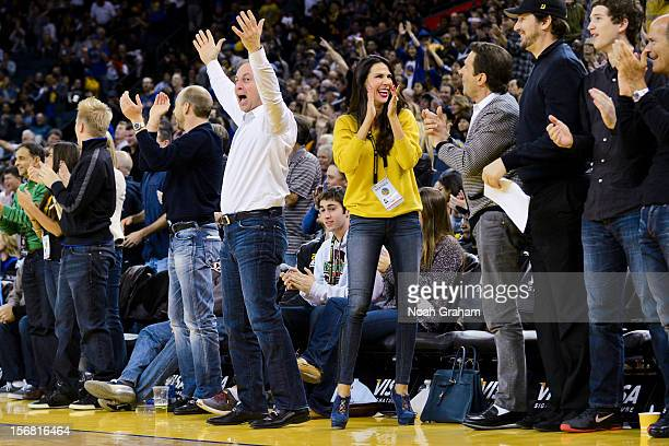 Golden State Warriors co-owners Joe Lacob, center left, and Peter Guber, center right, along with Lacob's fiancee Nicole Curran, cheer on the team...