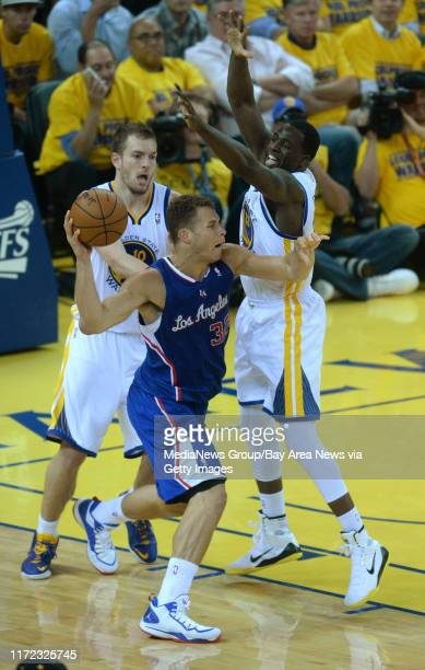Golden State Warriors' David Lee and Golden State Warriors' Draymond Green guard against Los Angeles Clippers' Blake Griffin in the second quarter of...