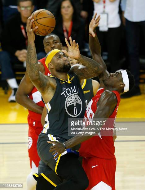 JUNE 13 Golden State Warriors' DeMarcus Cousins drives against Toronto Raptors' Pascal Siakam during the fourth quarter of Game 6 of the NBA Finals...