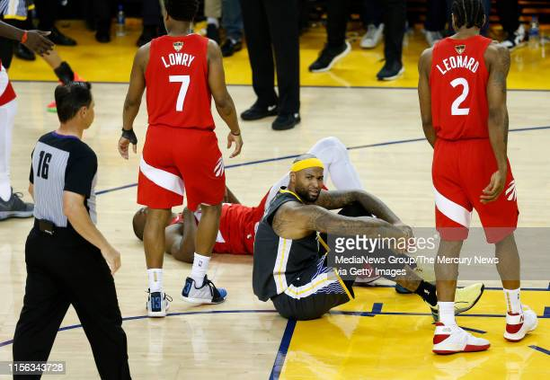 JUNE 13 Golden State Warriors' DeMarcus Cousins sits on the court after being fouled during the fourth quarter of Game 6 of the NBA Finals against...