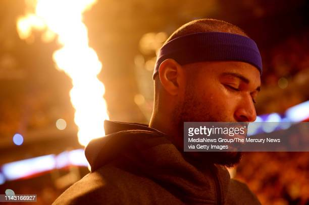Golden State Warriors' DeMarcus Cousins stands for the National Anthem before the start of Game 2 of an NBA first round playoff series against the...
