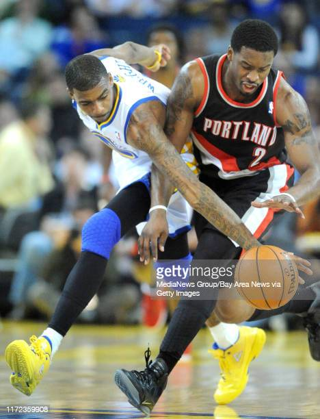Golden State Warriors' Dorell Wright left steals the ball away from Portland Trail Blazers guard Wesley Matthews in the first period of their...