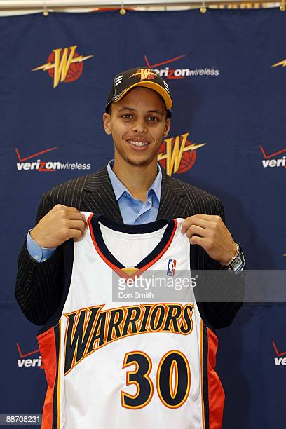 Golden State Warriors draft pick Stephen Curry poses with his team jersey at the Warriors practice facility June 26 2009 in Oakland California NOTE...
