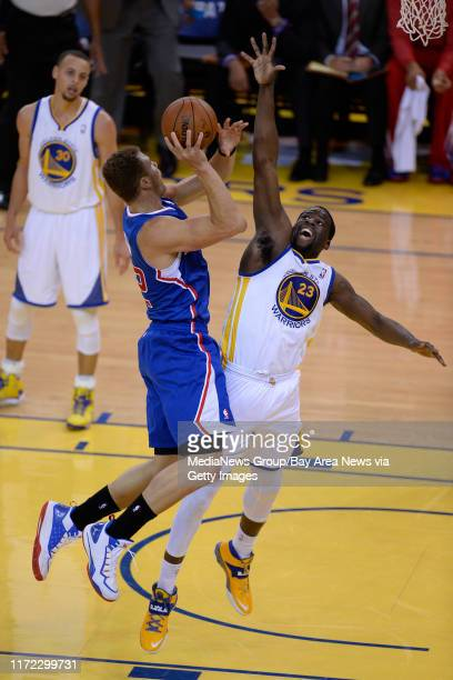 Golden State Warriors' Draymond Green guards Los Angeles Clippers' Blake Griffin in the quarter of Game 4 of their Western Conference NBA playoff at...
