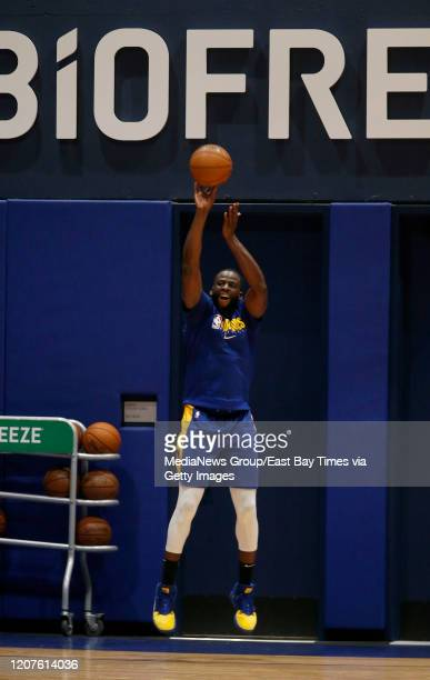 Golden State Warriors' Draymond Green shoots during practice at the Biofreeze Performance Center in San Francisco Calif on Wednesday Feb 19 2020