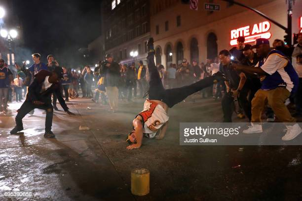 Golden State Warriors fans celebrate outside of Oakland City Hall on June 12 2017 in Oakland California The Golden State Warriors defeated the...