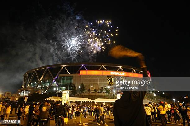 Golden State Warriors fans celebrate their team's 2015 NBA Finals win in front of Oracle Arena on June 16 2015 in Oakland California This is the...