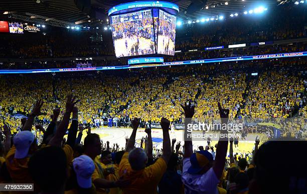 Golden State Warriors fans celebrate victory over the Cleveland Cavaliers in Game 1 of the 2015 NBA Finals in Oakland California on June 4 2015 The...