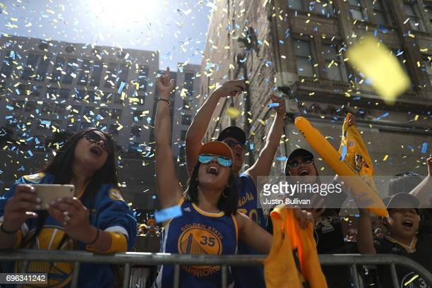 Golden State Warriors fans cheer during the Warriors Victory Parade on June 15 2017 in Oakland California An estimated crowd of over 1 million people...
