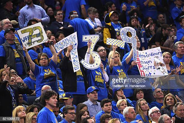 Golden State Warriors fans hold signs in the second half during the game between the Memphis Grizzlies and the Golden State Warriors at ORACLE Arena...