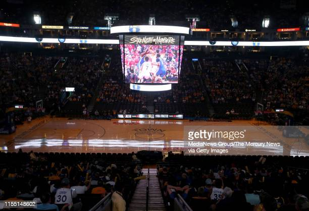 Golden State Warriors fans watch on the jumbotron during an NBA Finals Game 5 watch party at Oracle Arena in Oakland Calif on Monday June 10 2019 The...