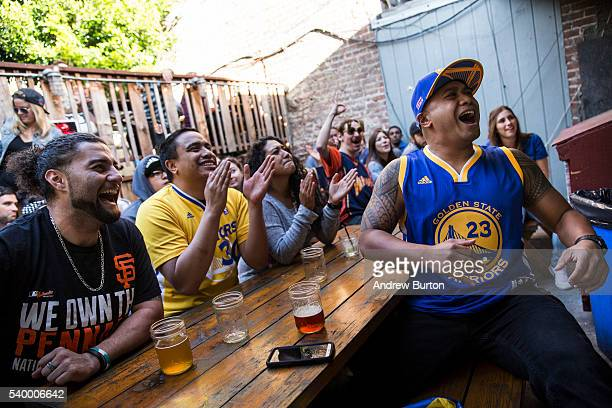Golden State Warriors fans watch the first quarter of Game 5 of the 2016 NBA Finals between the Warriors and the Cleveland Cavaliers on June 13, 2016...