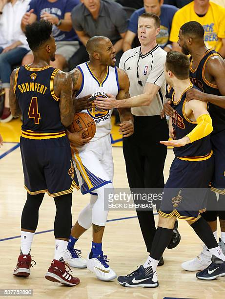 Golden State Warriors forward Andre Iguodala and Cleveland Cavaliers guard Matthew Dellavedova are separated after sharing words during the third...