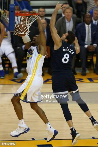 Golden State Warriors forward David West slams the ball against Nemanja Bjelica during an NBA game against the Minnesota Timberwolves on November 08...