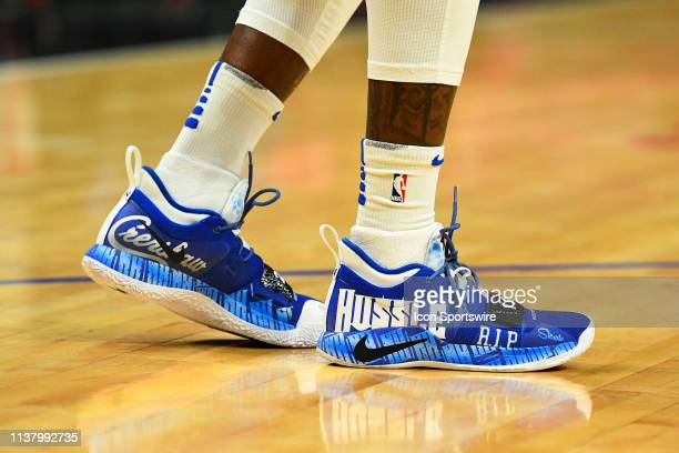 Golden State Warriors Forward Jordan Bell shoes in honor of Rapper Nipsey Hussle before game two of the first round of the 2019 NBA Playoffs between...