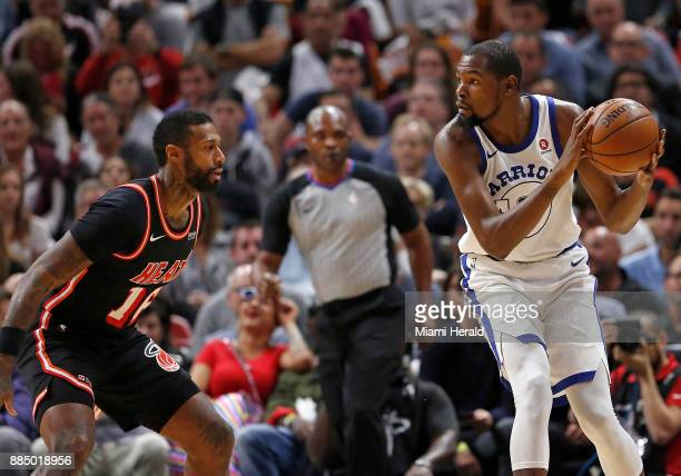 Golden State Warriors forward Kevin Durant drives against Miami Heat forward James Johnson during the first quarter on Sunday Dec 3 2017 at...