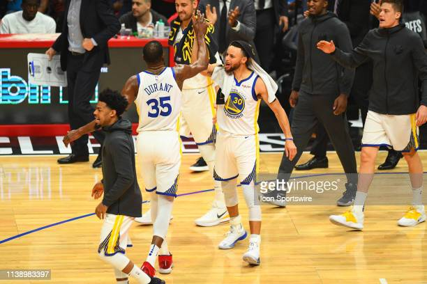 Golden State Warriors Forward Kevin Durant gets a high five from Golden State Warriors Guard Stephen Curry during game four of the first round of the...